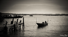 The rustic allure of Pulau Ubin (gunman47) Tags: 2016 asia b bw mono monochrome november pulau sea sg sepia singapore ubin w black bumboat charm jetty landscape old pace photography slow white world boat outdoor water waterfront sky rustic allure