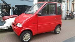 Canta LX (Michel Curi) Tags: amsterdam netherlands holland nederland centrum dutch iamsterdam schiphol europe grotemarkt canals canta cantalx microcar red cars auto automobile coches vehculos vehicle automvil carros car voiture automobiel transportation motorcycle
