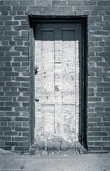 DoorLocked-EvartsKY1987 (Zzzzt!Zzzzt!) Tags: door doorseries street streetphotography evartsky locked peelingpaint crumbling blocked bricked doortraits