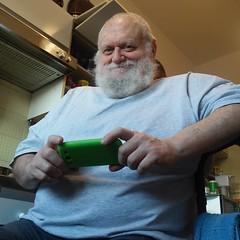 Pigi gioca col telefono (orsorama) Tags: bear beard orso barba telefono cell