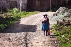 Walking Home (kate willmer) Tags: hat shawl bag woman road street walking houses altiplano peru