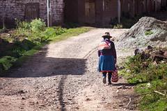 Walking Home (kate willmer) Tags: hat shawl bag woman road street walking houses altiplano peru