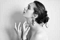 innocence (petuulia) Tags: portrait bw white black earings self hands lips