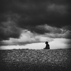 Stolen youth (martinfowlie) Tags: sky beach grass clouds dark suffolk child sad dusk shingle rise contemplative rootsmanuva stolenyouth