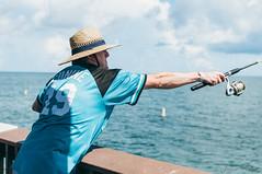 Fishing (corran105) Tags: ocean gulfofmexico hat sunshine pier fishing nikon raw gulf tampabay sunny cast jersey clearwaterbeach fishingpole clearwater lightroom gulfcoast marlins conine fishingrod pier60 d90 nikond90 vsco vscofilm