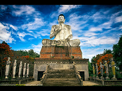 Unfinished Business in Battambang, Cambodia (Sam Antonio Photography) Tags: old travel vacation sculpture white holiday building art history monument statue rock stone architecture clouds giant asian religious ancient worship asia cambodia meditate cambodian khmer artistic god head antique buddha buddhist religion pray buddhism landmark angkorwat carving human ek siemreap angkor wat pilgrimage phnom battambang bayon placeofworship buddhastatue travelphotography traveldestinations ekphnom bambootrain easternreligion watekphnom battambangcambodia canoneos5dmarkii samantonio samantoniophotography southeastasiaphotography unfinishedbuddha