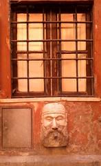 Roma ago 2014 piazza San Silvestro (Nonnismi) Tags: italy rome roma window digital italia samsung finestra colori passato basrelief scultura ferro antichità sbarre mobilephotography fotografiadigitale