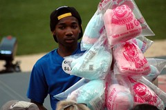 Cotton candy, get your cotton candy! (kennethkonica) Tags: people usa men america outdoors nikon midwest baseball action indianapolis hats indy indiana games nikond70s plastic cottoncandy uniforms selling hoosiers vendors indianapolisindians thetribe tripleabaseball victorystadium