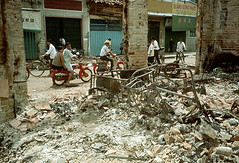 CHOLON 1968 - Moped Riders Passing Destroyed Building - ng ng Khnh (manhhai) Tags: asia cholon disasteranddestruction group hochiminhcity people saigon southvietnam southeastasia southeastregion vietnam vietnamwar19591975