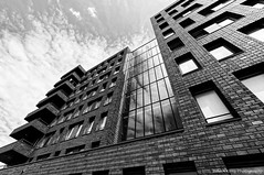 Sky building (Johan Konz) Tags: apartmentbuilding apartment building architecture weidevenne purmerend netherlands vinexsite outdoor windows pattern abstract straight geometric urban blackandwhite monochrome diagonal city bw