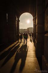Tunnel Penumbras (Nuzulu) Tags: vienna austria people sunset shadows contrast archway