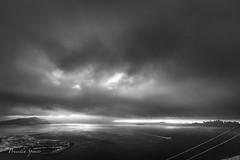 Racing the Storm (priscellie) Tags: sanfrancisco goldengate goldengatebridge california bridge clouds cloudy sunrise marinheadlands