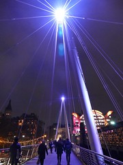 Follow that star (Englepip) Tags: star follow guiding christmas thames bridge footbridge jubilee golden hungerfordbridge crowd people london crossing cables architecture lights night charingcross purple
