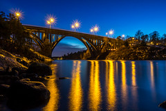 Evening Bridge (Jens Haggren) Tags: olympus em1 bridge arch road sky water reflections lights rocks trees houses landscape view skurubron skurusundet nacka sweden jenshaggren
