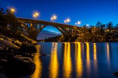 Evening Bridge (Jens Haggren) Tags: olympus em1 bridge arch road sky water reflections lights rocks trees houses landscape view skurubron skurusundet nacka sweden jenshaggren