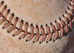 Daisy Cutter (Helen Orozco) Tags: macromondays stitch baseball ball canonrebelsl1 hmm worn texture daisycutter