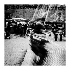 spinningchains (seba0815) Tags: ricohgrdiv grdiv monochrome chains spinning spinningchains carrousel fair christmas christmasmarket christmasfair child blurred people streetphotography streetshot blackwhite blackandwhite blanco nero blanc noir black white schwarzweis daylight day contrast square preset inspiredeye mood seba0815