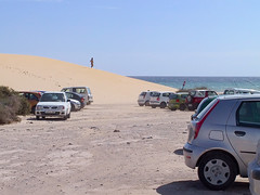 IMG_0437 (wildhareuk) Tags: beach carpark cars fuerteventura fuerteventura2003 jandia powershotpro90is sea sanddune