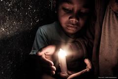 Light the candles (Safidy Andrianantenaina) Tags: fujifilm x100t slum streetphotography