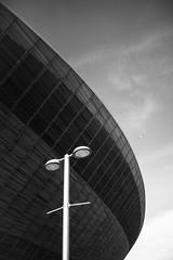 Velodrome 2 (marktmcn) Tags: undercroft olympic velodrome the pringle london lee valley velopark queen elizabeth park wood paneling sky sweeping curves d610 nikkor streetlamp street lamp blackandwhite monochrome