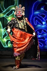 Face-Changer (tim.perdue) Tags: ohio chinese lantern festival 2016 exposition center fairgrounds columbus winter holiday christmas night dark lights colorful multicolored face changing dance entertainer performer costume cape fan traditional china silk