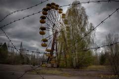 Wheel of misfortune (Kriegaffe 9) Tags: trees overgrown decay fair ukraine barbedwire ferriswheel bigwheel pripyat