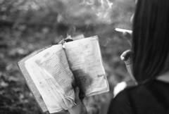 (Emily Savill) Tags: b portrait blackandwhite bw woman white black film girl strange fashion lady analog canon fire 1 book weird punk cigarette smoke w goth f1 smoking creepy iso holy odd burning burn f satan pro bible 100 analogue asa blasphemy legacy alternative atheist satanist blashpemer