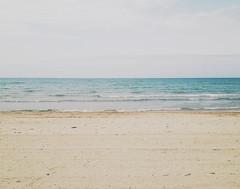 Shoreline (brittcorry) Tags: blue beach water lines horizontal landscape sand waves teal horizon shoreline shore