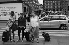 Travelers (Adam Chin) Tags: bw copenhagen denmark tourists zeissikon fujineopan400