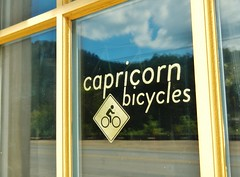 Front Door Signage (guidedbybicycle) Tags: sign gold leaf north marshall bicycles business signage carolina brass capricorn