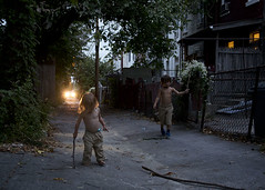 twilight (Blinkofanaye) Tags: street light sunset playing window car kids evening sticks twilight alley play headlights