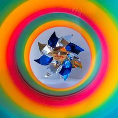 Slinky Tunnel (Angela Redmon) Tags: white studio toy framing slinky 1x1 colorimage stilllifephotography colourimage