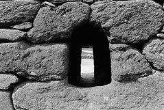 Gallarus Oratory 3 (Ian Atrus Gazzotti  iangazzotti.com) Tags: door ireland blackandwhite bw church window analog 35mm nikon bn hut beehive biancoenero irlanda oratory dinglepeninsula nikonf70 f70 gallarus clochn ringofdingle clochan
