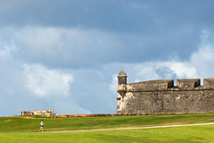 pr sj runner el morro-8875 (BrianOvercast.com) Tags: travel vacation people color colour green tower history wall clouds relax island exercise puertorico fort getaway lawn cityscapes run historic sanjuan tropical caribbean fitness runner turret jog morro fit jogger elmorro active exercising adultwoman womanrunning