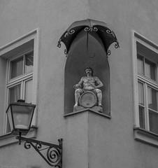 There was rain in Maribor (Harry -[ The Travel ]- Marmot) Tags: travel reis reizen traveling reisen sne nvbs sloveni slovenia maribor zwartwit blackandwhite bw monochroom monochrome schwarzweis man umbrella statue beeld art kunst allrightsreservedcontactmebyflickrmail