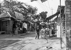 Village Bazar (Mijan Rashid) Tags: bazar rajshahi bangladesh asia asian canon canon1100d tamron tamron18270mm tamron18270 blackwhite black white bw day people road shop outdoor southasia travelphotography travel afternoon