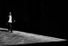chiaroscuro (Georgie Pauwels) Tags: chiaroscuro minimal minimalism street dark negativespace streetphotography candid walking fujifilm blackandwhite contrast