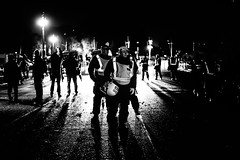 Going Home (Sean Batten) Tags: millionmaskmarch london england unitedkingdom gb police policeman blackandwhite bw streetphotography street nikon df 50mm buckinghampalace