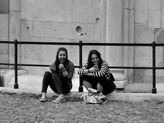 that's hilarious (Stefano E) Tags: modena italia italy duomodimodena emiliaromagna girls laugh biancoenero blackandwhite blackwhite street strada candid candidstreet women ragazze urban italians people peoplesitting allaperto girl bn monocromo monochrome