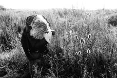 Katia shoots the flowers (Jon & Katia) Tags: landscape devilsdyke rx100iv sonyrx100m4 sony highcontrast monochrome blackandwhite photographer wife girl