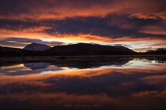 Magic sunrise (Christian Uhlig) Tags: europe northernnorway prestvatn tromscounty tromsdalstinden troms㸠arcticlight cluds colorful lake lakeice mountains reflection sunrise