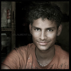 Handsome Devil (designldg) Tags: india indiasong uttarpradesh varanasi benares benaras kashi people portrait photography panasonicdmcfz18 man maleportrait happiness smile handsome sepiaandcolor soul square skin expression emotion eye ethereal naturallight nostalgia colours closeup composition texture dharma celebratehumanity indian outdoor youth timeless theoldestlivingcityintheworld travel laurentgoldstein streetphotography streetlife chiaroscuro clairobscur candid
