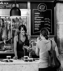 Spanish Store - Borough Market - Southwark (BW) (Olympus OMD EM5 & Panasonic 42mm Prime) (markdbaynham) Tags: leica city uk people urban bw white black london monochrome lens four prime candid capital evil olympus panasonic micro gb third metropolis asph southwark dg omd csc f12 m43 mft em5 u43 425mm micro43 m43rd u43rd nocticron