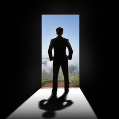 Businessman at the door (Patrick Foto ;)) Tags: door city boss sky people opportunity mountain man men home window businessman wall landscape creativity leaving person idea freedom design marketing stand wooden back open view bright interior room rear creative young entrance business indoors doorway human thinking inside concept copyspace emotions success briefcase leadership forward decisions