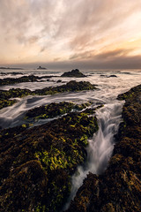 Through the Cracks (killersnowman) Tags: ocean california sunset sea beach rock cali clouds coast pacific sony calm sansimeon blancas sanluisobispo hwy1 piedras ca1 a7r
