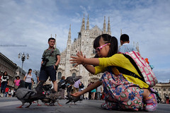 The Duomo, kids & pigeons (amira_a) Tags: italy milan kids square italia fuji milano pigeons explore getty fujifilm piazza duomo 67 gettyimages piccioni x100 sooc x100s 03082014
