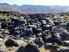 At Fossil Falls, CA-395, Inyo Co., CA (ArgyleMJH) Tags: california iceage lava redhill geology basalt cindercone owensriver lavaflows pleistocene fossilfalls volcanics drywaterfall ca395 cosovolcanicfield paleochannel
