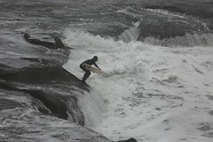 Surfer Timing to Take the Plunge into the Surging Gut Flat Rock Muriwai New Zealand (eriagn) Tags: sea newzealand weather sport swimming photography coast marine surf waves weekend surfer floating overcast auckland foam surfboard northisland surfers recreation tasmansea westcoast dull leaping wetsuit hightide drizzle competent seaspray flatrock muriwai surging rockplatform foamingsea eriagn ngairelawson ngairehart