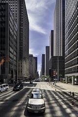 Caddy on 6th Avenue (C. Waeber) Tags: newyork cars architecture america buildings reflections police nypd cadillac avenue bigapple radiocity sunnyday avenueoftheamericas
