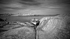 boat and rocks (Andreas Lööf) Tags: sea sky blackandwhite bw seascape nature water monochrome clouds landscape island boat rocks sweden tripod le lonely archipelago östersjön smallboat sigma1020mm bwfilter ndfilter sonyalphaslta77